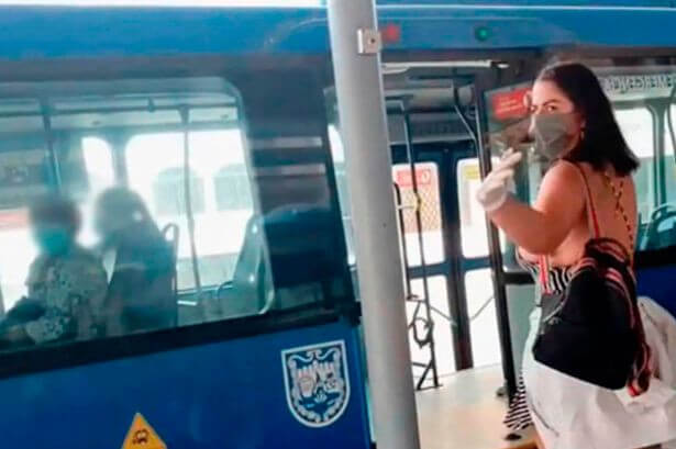 A Porn star is wanted by police after filming a sex scene on a bus without a face mask ( Scene photos) 2